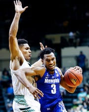 Memphis guard Jeremiah Martin (right) drives the lane against USF defender Xavier Castaneda (left) during action in Tampa, Saturday, February 2, 2019.