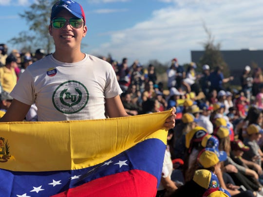 Daniel Fuenmayor, 18, of Lakeland, rallies at Shelby Farms Park in support of Venezuelan leader Juan Guaido.