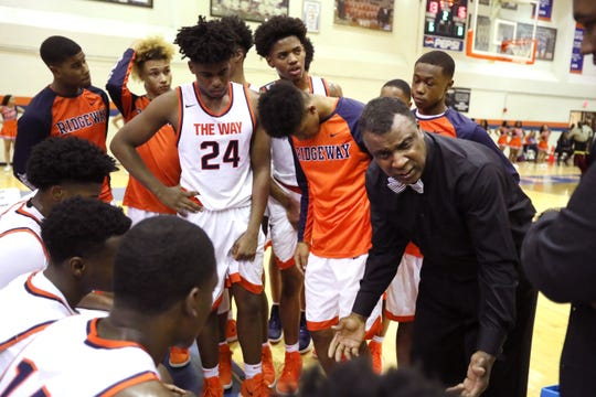 Ridgeway Head Coach Wesley Henning talks to his team during a timeout in their game against Southwind on Friday, Feb. 1, 2019.