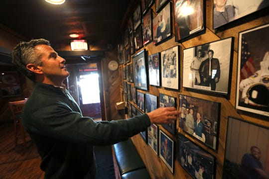 Barry Pelts looks over photos from the past 30 years at Corky's BBQ where his father opened the Poplar Avenue restaurant in 1984.