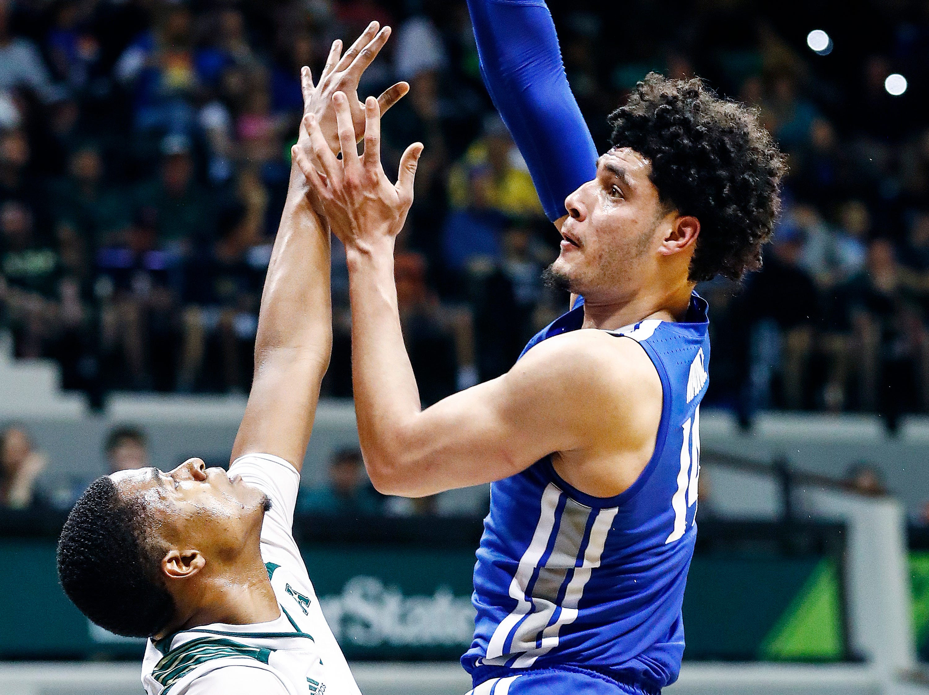 Memphis forward Isaiah Maurice (right) puts up a shot against the USF defense during action in Tampa, Saturday, February 2, 2019.