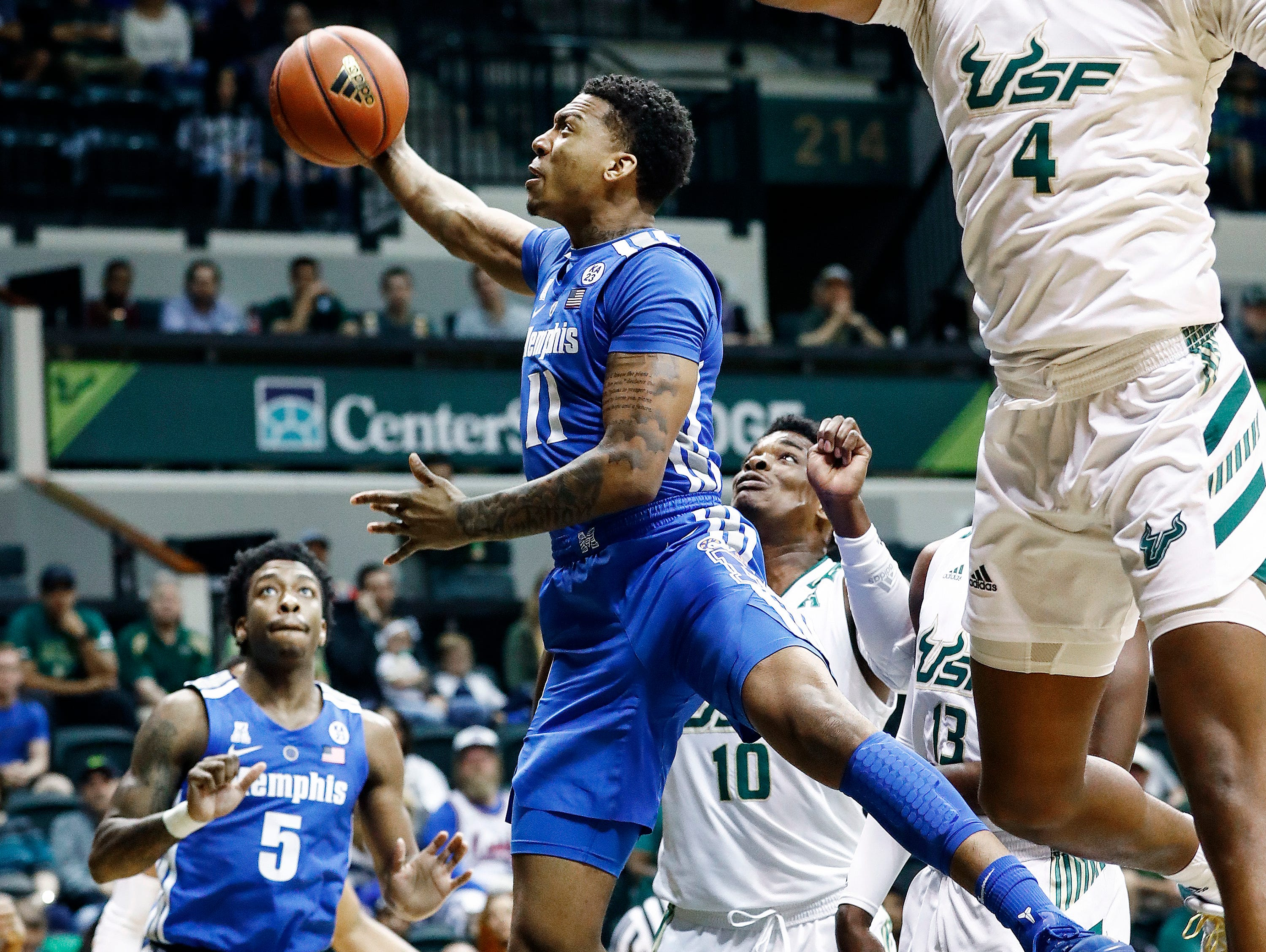 Memphis guard Antwann Jones (middle) misses a layup against the USF defense during action in Tampa, Saturday, February 2, 2019.