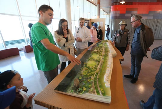 George Abbott, left, the director of external affairs for the Memphis River Parks Partnership, introduces a scale model with plans for the future of Tom Lee Park at the Beale Street Landing on Feb. 2.