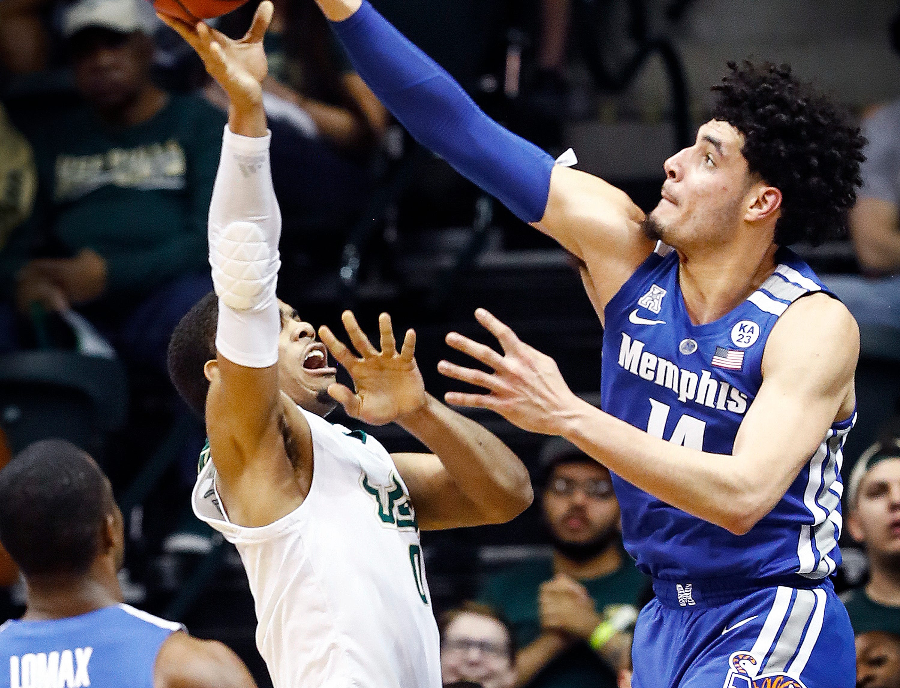 Memphis defender Isaiah Maurice (right) blocks the shot of USF guard David Collins (left) during action in Tampa, Saturday, February 2, 2019.