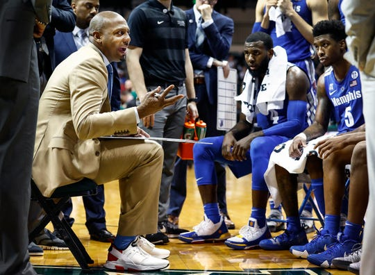 Memphis head coach Penny Hardaway directs his players  during a timeout against USF in Tampa, Saturday, February 2, 2019.