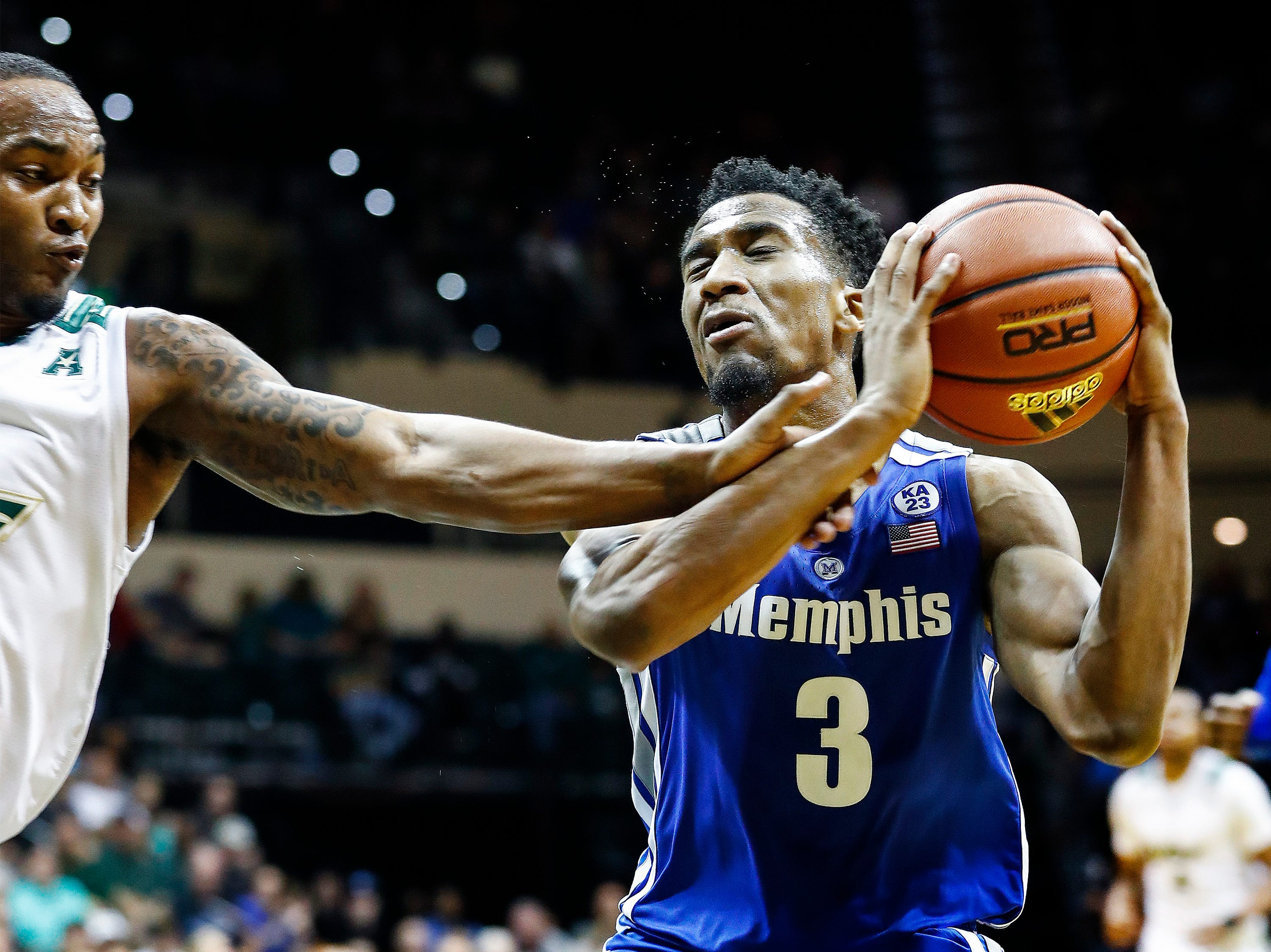 Memphis guard Jeremiah Martin (right) is fouled while driving the lane against USF defender Laquincy Rideau (left) during action in Tampa, Saturday, February 2, 2019.