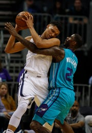 Memphis Grizzlies forward Ivan Rabb, left, keeps the ball from Charlotte Hornets forward Marvin Williams in the first half of an NBA basketball game in Charlotte, N.C., Friday, Feb. 1, 2019. (AP Photo/Nell Redmond)