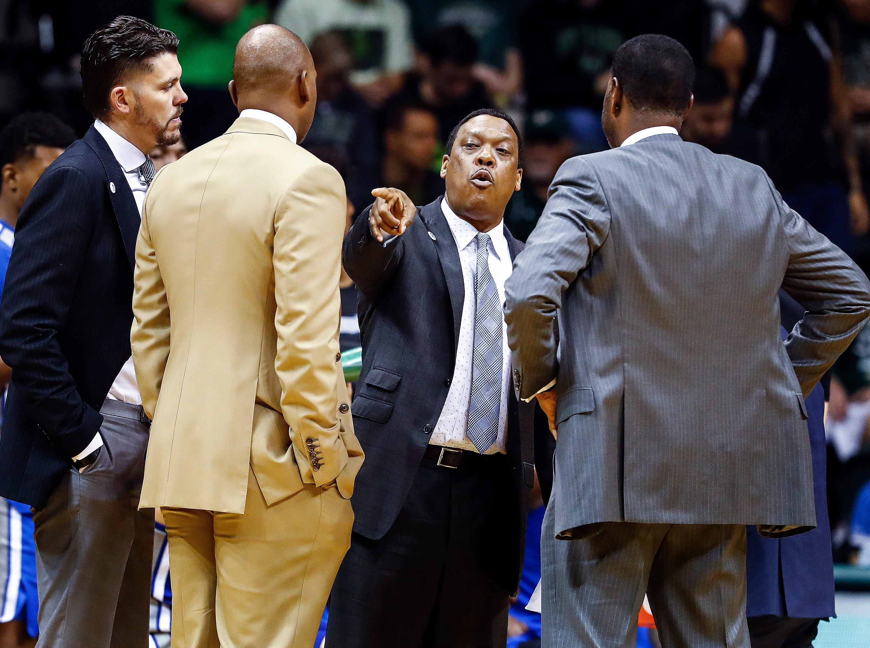 Memphis assistant coach Tony Madlock (middle) during a break in action against USF in Tampa, Saturday, February 2, 2019.