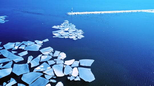 Sheets of ice float on Lake Michigan just inside the breakwater near the Milwaukee Community Sailing Center in Veterans Park Feb. 14, 2018.