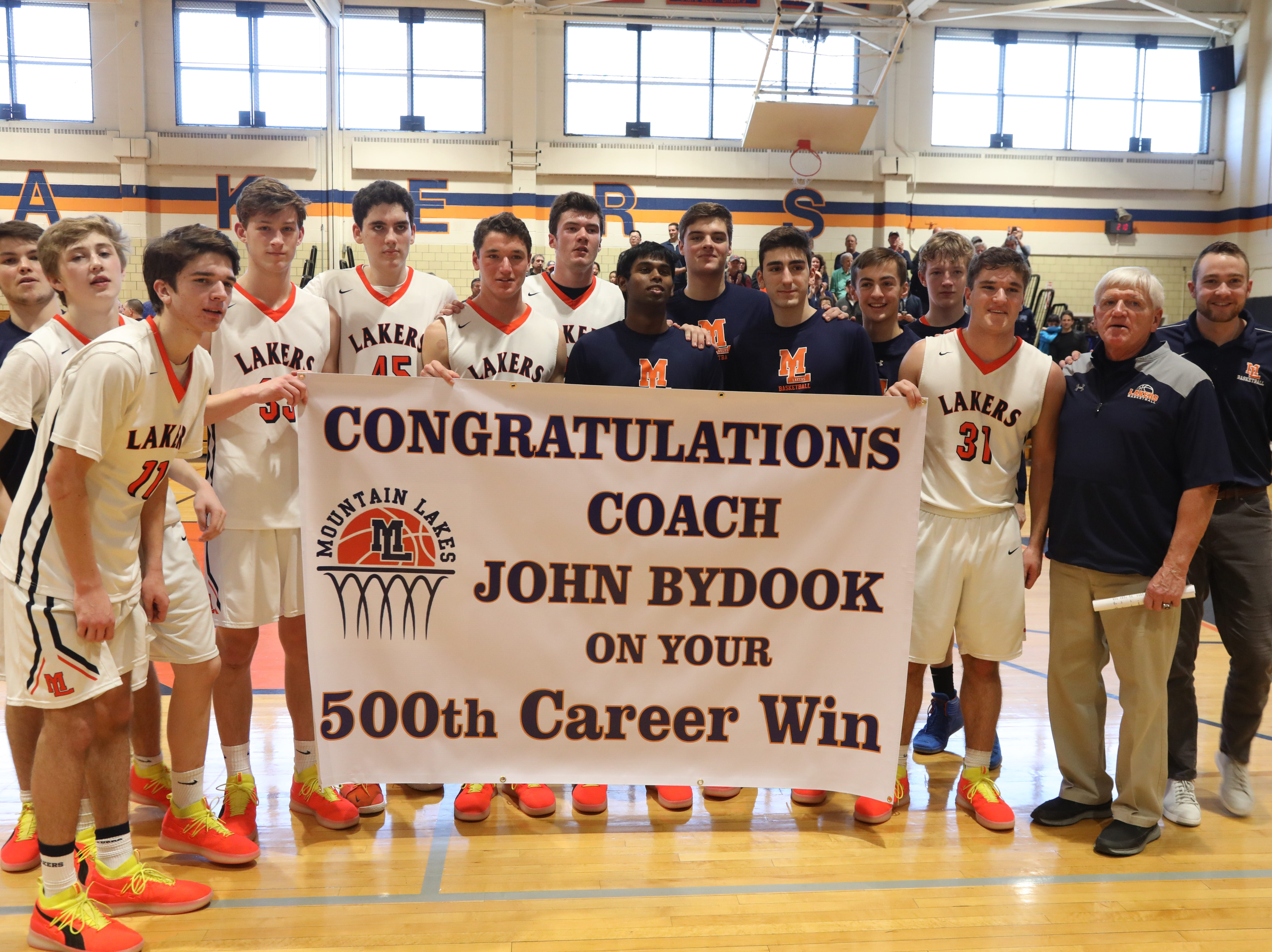 Mt. Lakes head coach John ByDook is honored at the end of the game after he recorded his 500th career win.