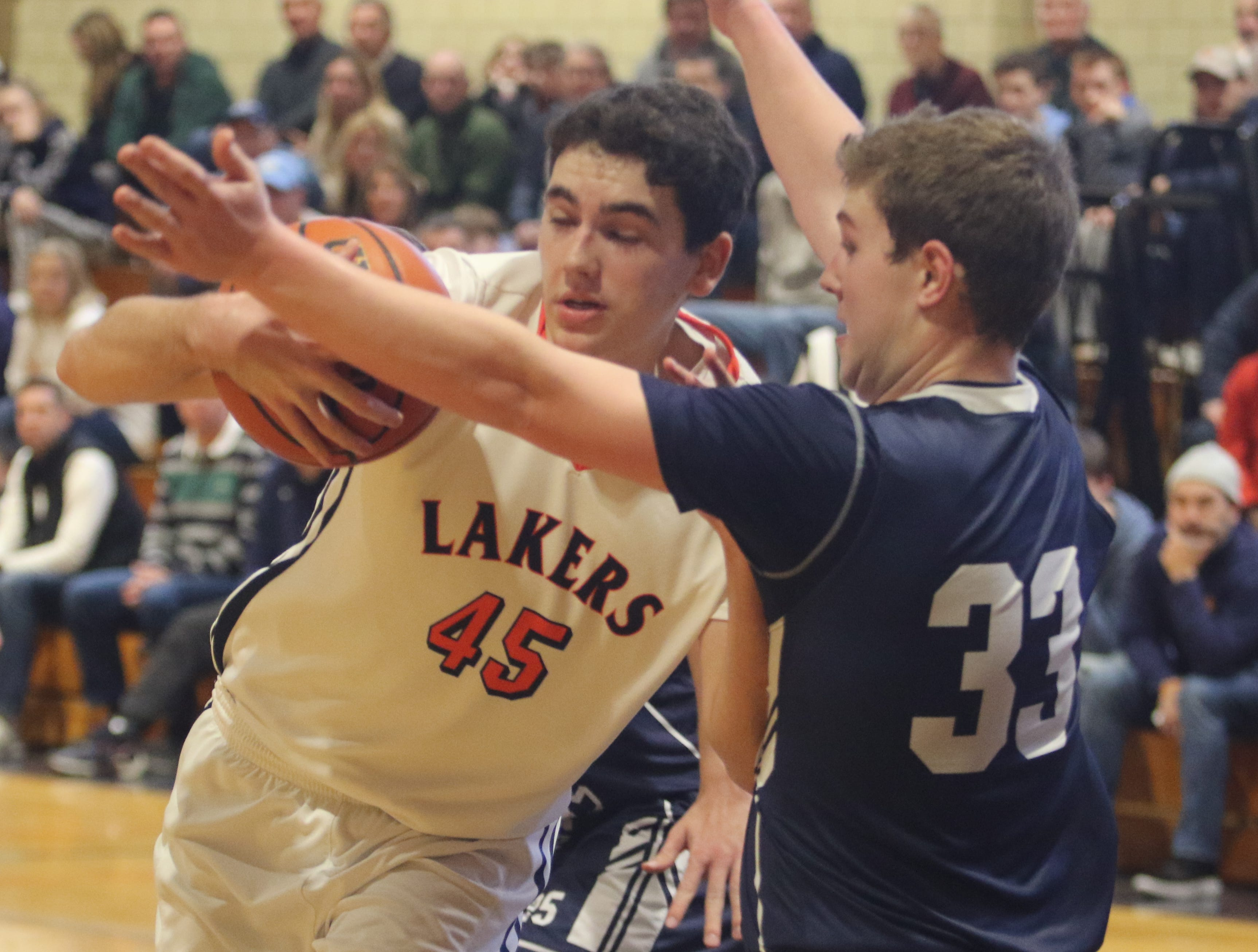 Spencer Myler of Mt. Lakes drives on Andrew Bergman of Chatham late in the game.