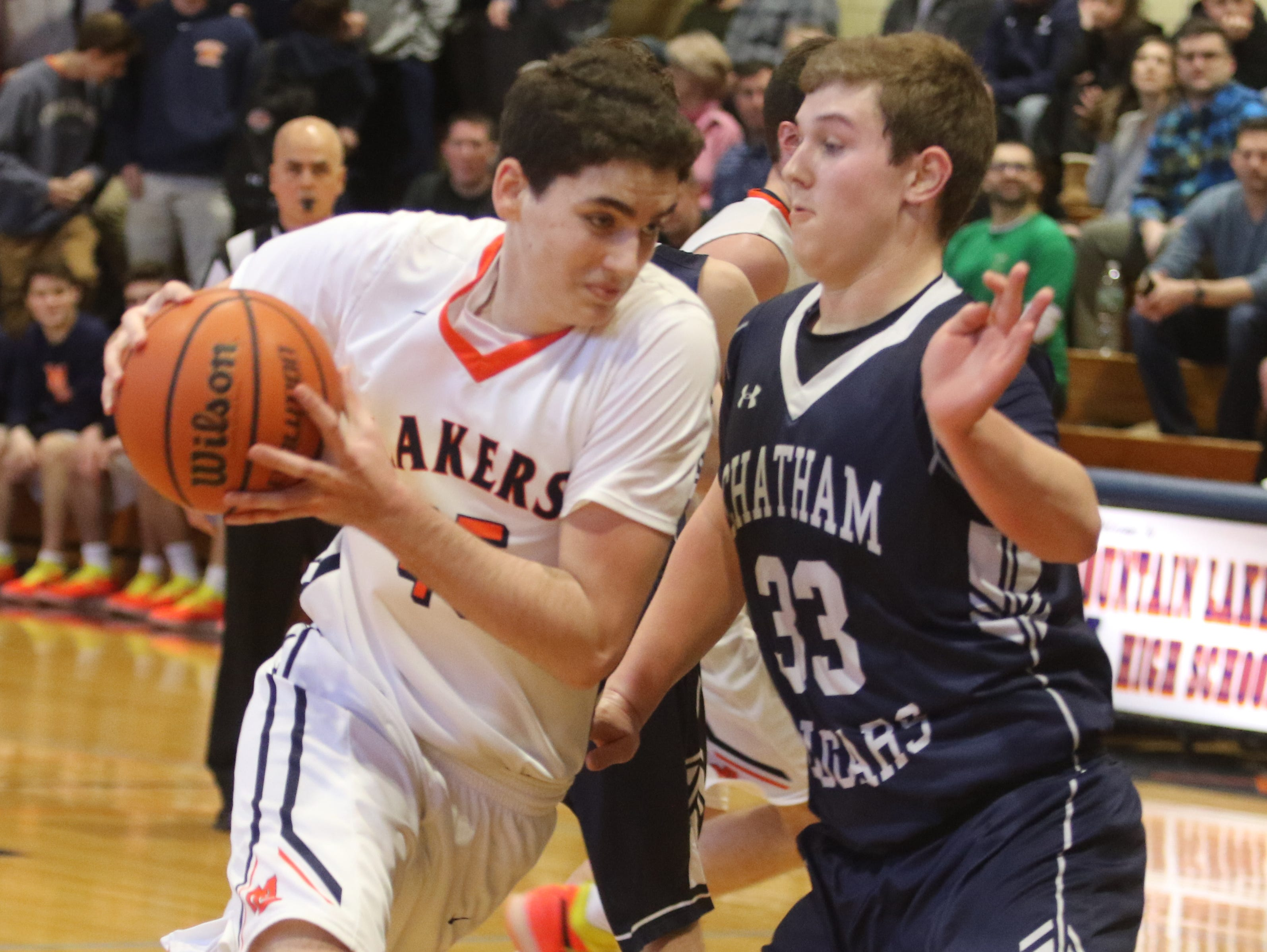 Spencer Myler of Mt. Lakes drives on Andrew Bergman of Chatham in the first half.