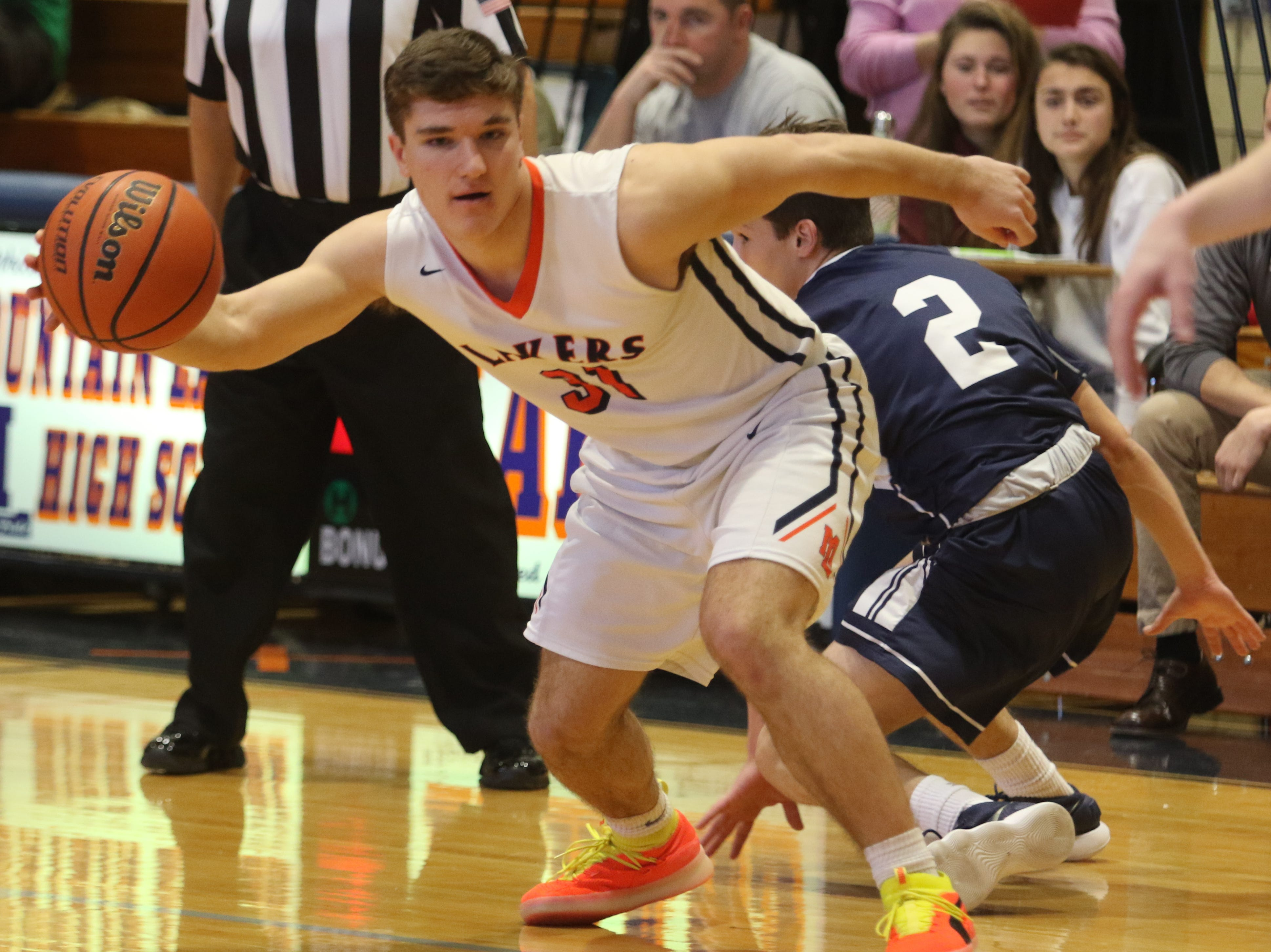 Jason Luzzi of Mountain Lakes dribbles the ball in the offensive zone in the first half.