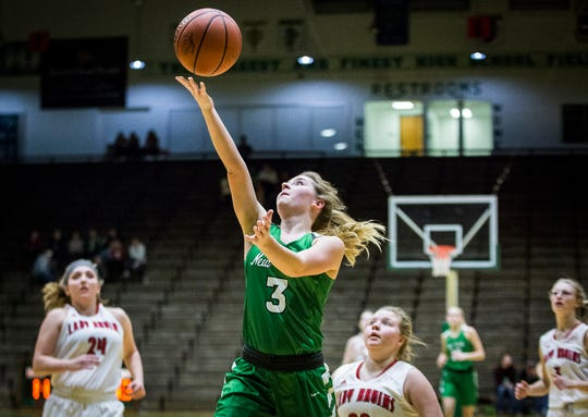 New Castle's Cloie York shoots past Blackford's defense during their sectional game at New Castle High School Friday, Feb. 1, 2019.