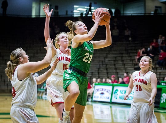 New Castle's Cameron Tabor shoots past Blackford's defense during their sectional game at New Castle High School Friday, Feb. 1, 2019.