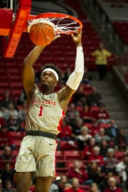 Ball State's K.J. Walton dunks during the game against Kent State on Saturday at Worthen Arena.