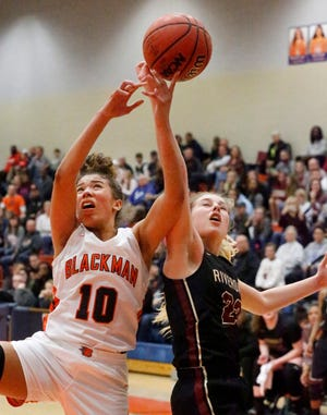 Blackman's Jaida Bond (10) and Riverdale's Jalyn Holcomb (23) go after a rebound on Friday, Feb. 1, 2019.