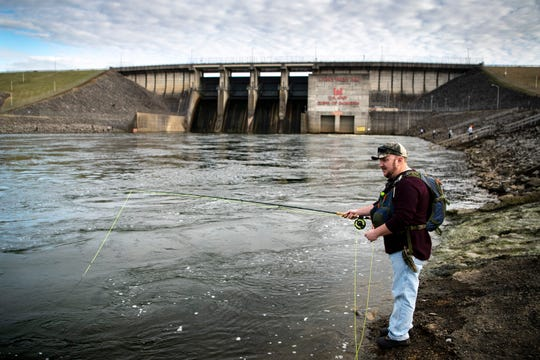 Mike Widrig, of Mount Juliet, Tenn., fishes at J. Percy Priest Dam in Nashville, Tenn., Saturday, Feb. 2, 2019. The temperature reached the low 60s on Saturday afternoon in the Nashville area.