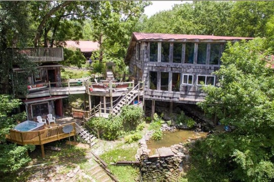 The main house, attached walkway and treehouse at 3052 Old New Cut Road in Springfield.