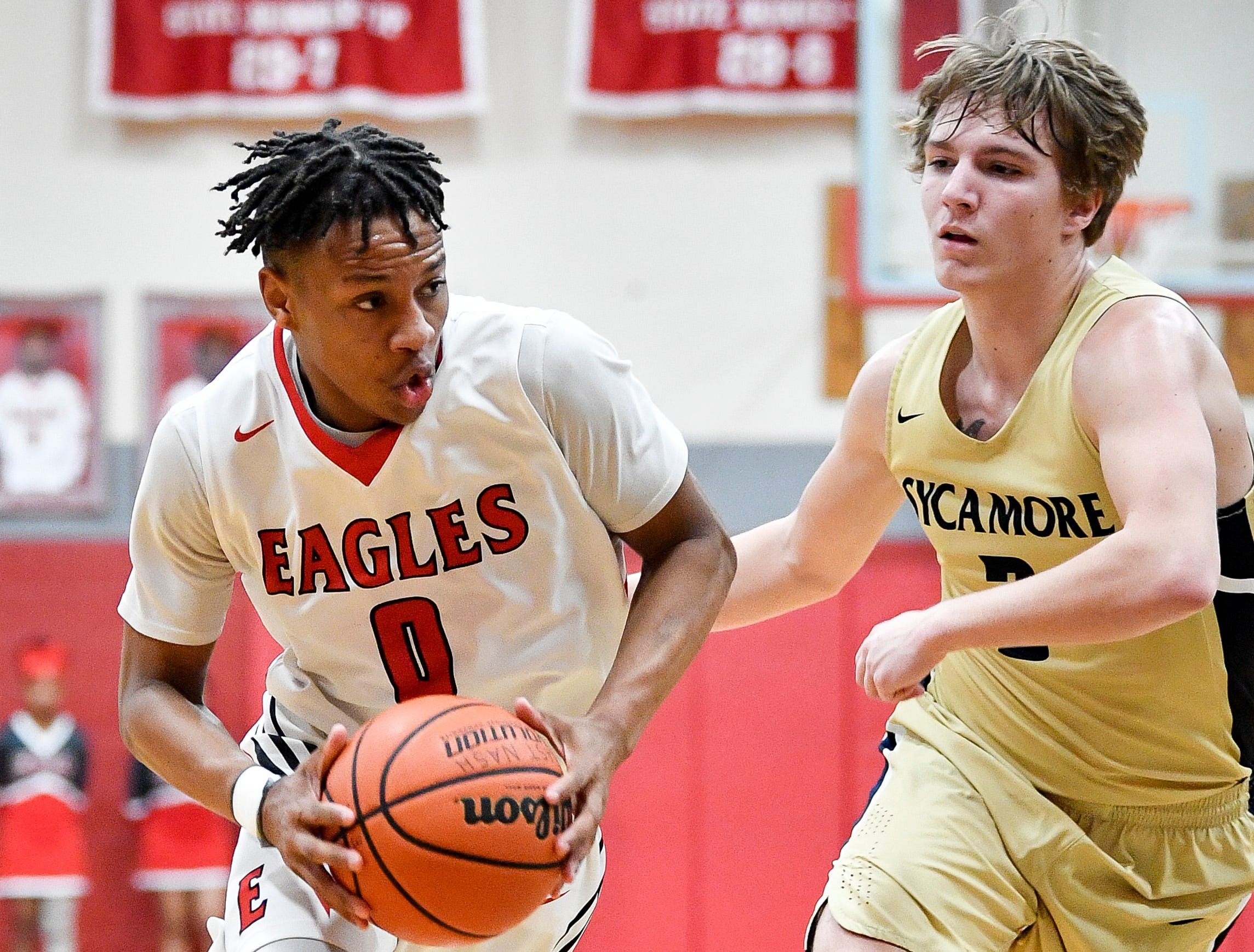 East Nashville's Taras Carter (0) advances past Sycamore's Trevor Gagnon (3) during the second half at East Nashville Magnet High School in Nashville, Tenn., Friday, Feb. 1, 2019.