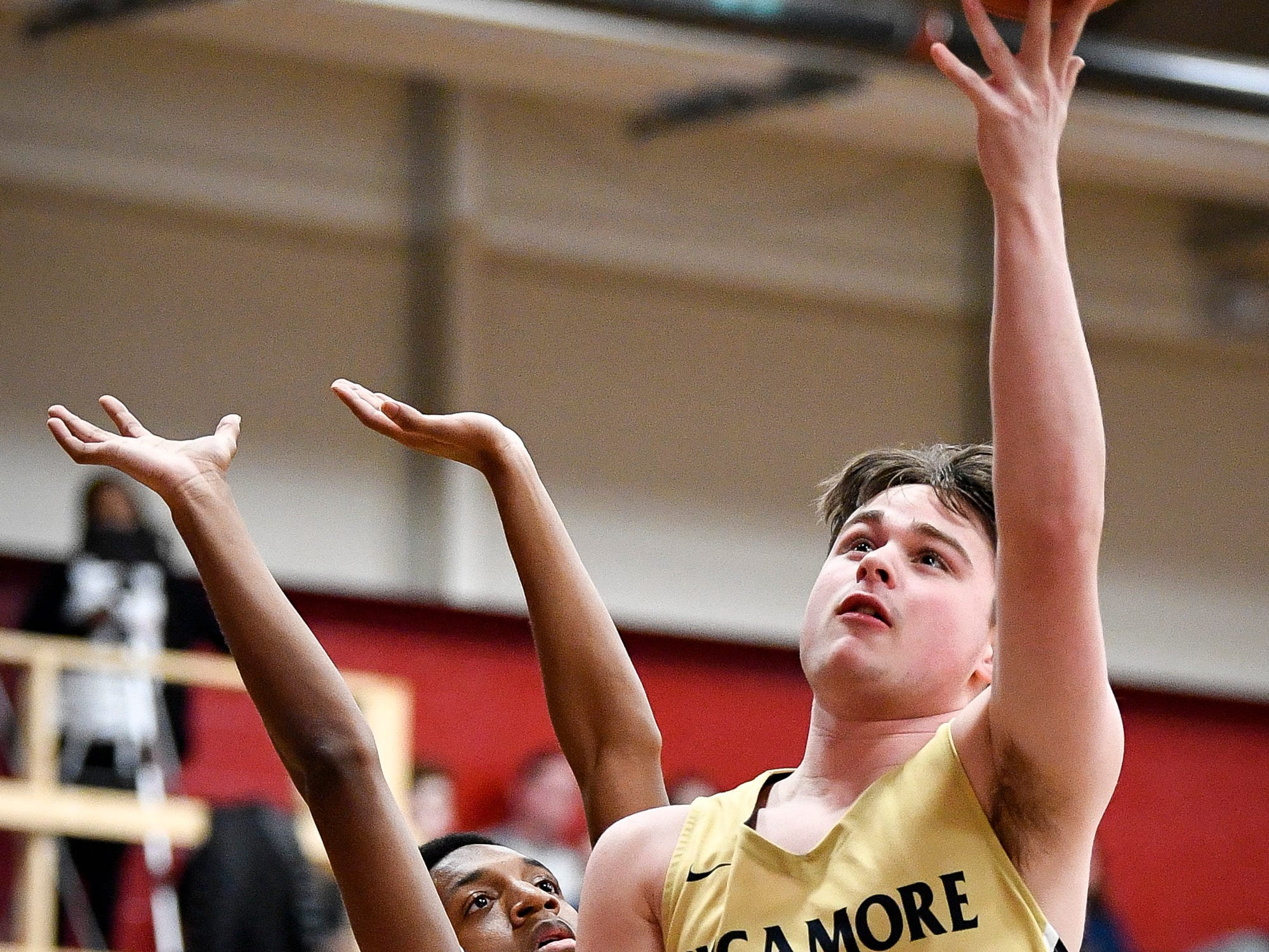 Sycamore's Dalton Dutton (31) shoots past East Nashville's Caleb Grimes (3) during the first half at East Nashville Magnet High School in Nashville, Tenn., Friday, Feb. 1, 2019.