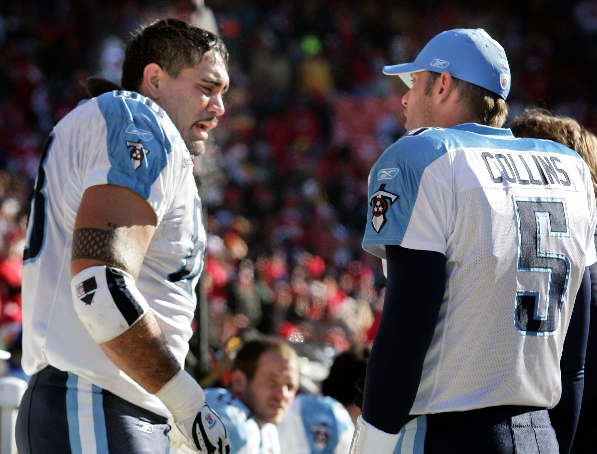 Tennessee Titans' Kevin Mawae (68) talks with teammate Kerry Collins (5) on the sideline after Mawae injured himself in during their game against the Chiefs at Arrowhead Stadium in Kansas City Mo., on December 16, 2007