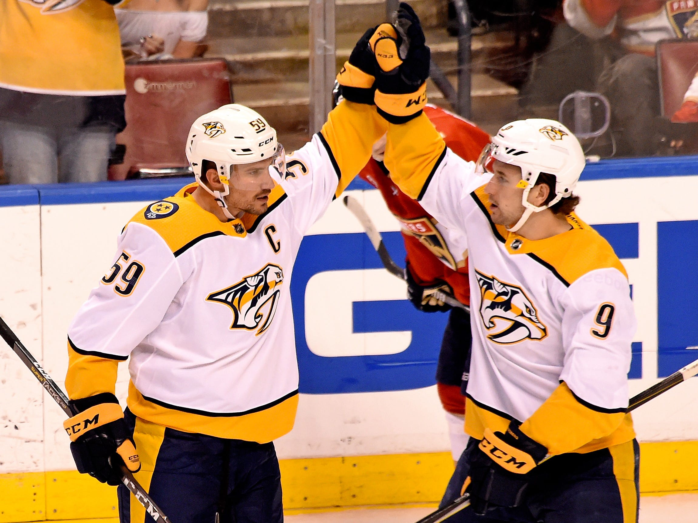 Nashville Predators defenseman Roman Josi (left) celebrates after scoring a goal with teammate Nashville Predators left wing Filip Forsberg (right) during the third period against the Florida Panthers at BB&T Center.