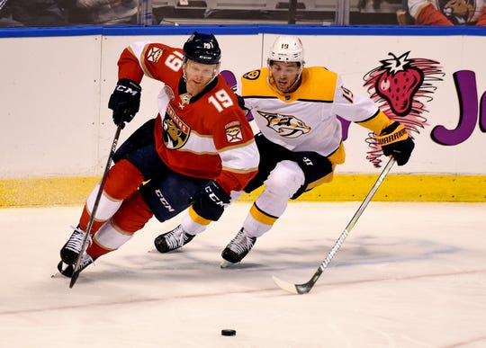 Feb 1, 2019; Sunrise, FL, USA; Florida Panthers defenseman Mike Matheson (19) controls the puck from Nashville Predators center Calle Jarnkrok (19) during the second period at BB&T Center. Mandatory Credit: Steve Mitchell-USA TODAY Sports