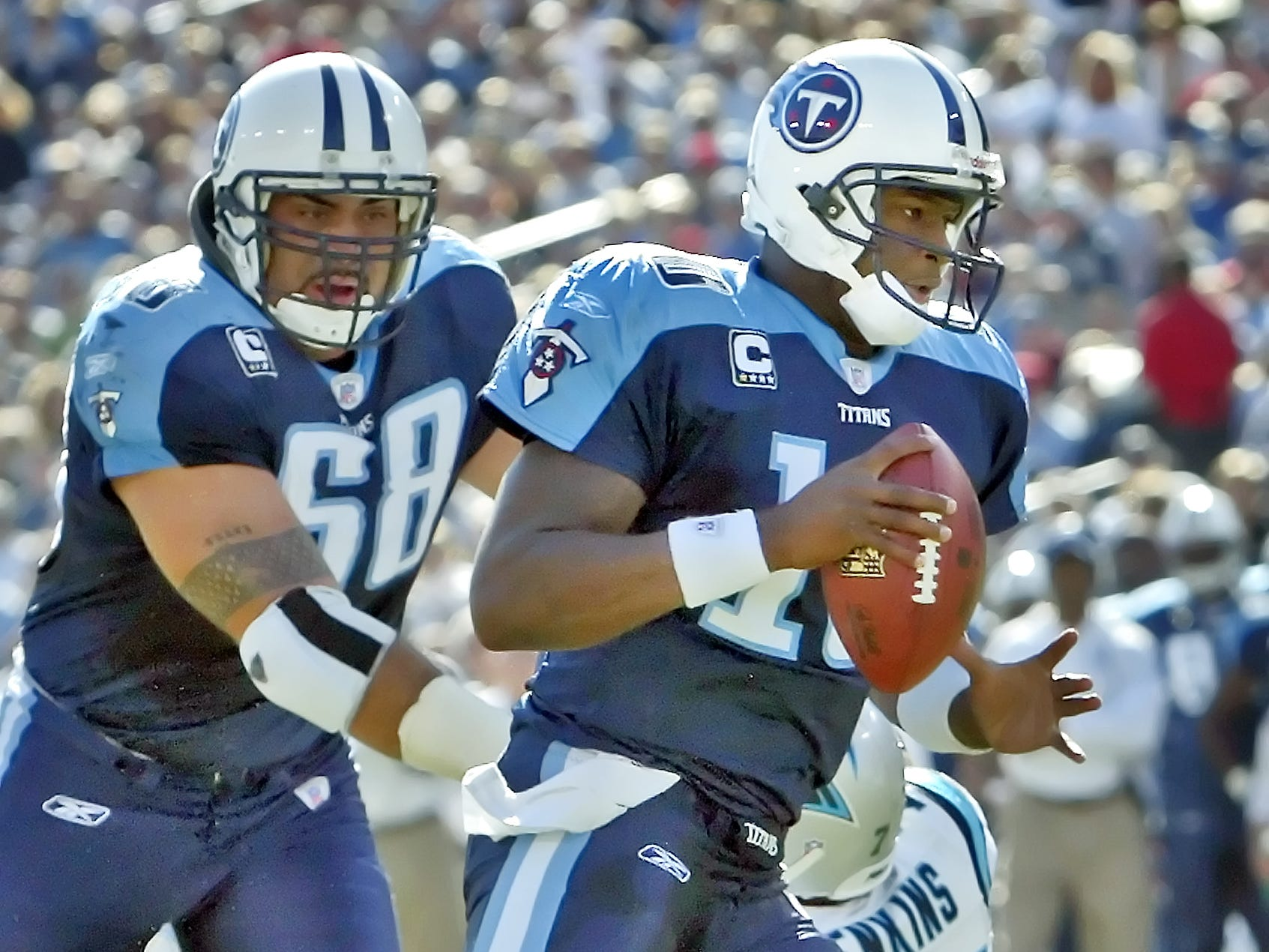 Tennessee Titans quarterback Vince Young (10) scores a touchdown as Kevin Mawae (68) looks on during the first quarter against Carolina Panthers at LP Field in Nashville, Tenn., Sunday, Nov. 4, 2007.