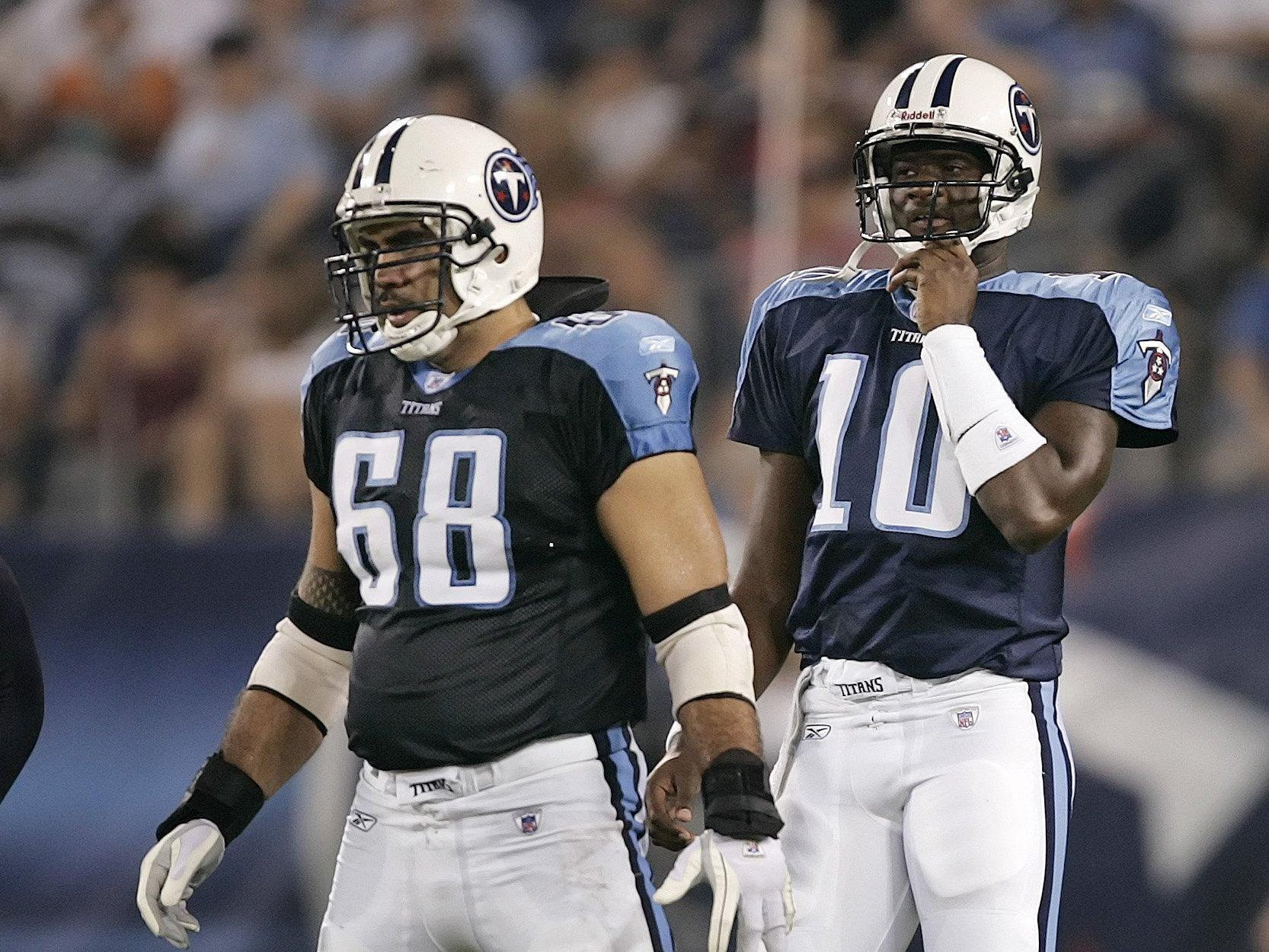 Tennessee Titans center Kevn Mawae (68) lines up in front of quarterback Vince Young (10) durinig their pre-season football game against the New Orleans Saints in Nashville, Tenn. on Aug. 12, 2006.