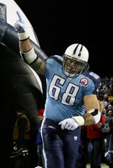 Tennessee Titans center Kevin Mawae (68) points to the sky as he comes out of the tunnel during introduction before the start their game against the San Diego Chargers at LP Field.