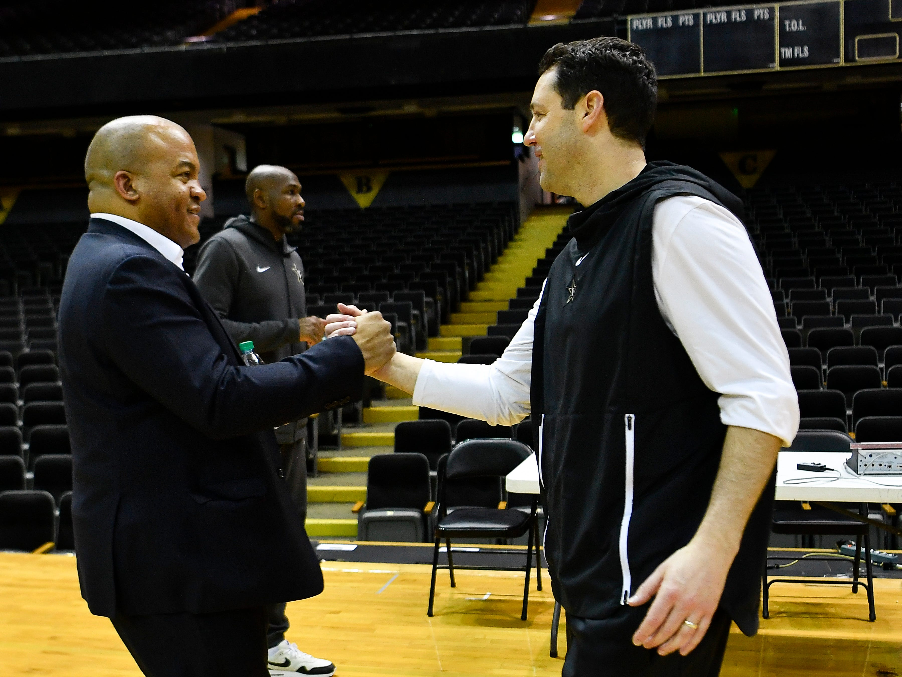 Vanderbilt's new athletic director Malcolm Turner shakes hands with basketball coach Bryce Drew as he visits with the athletic programs during his first day on campus Friday Feb. 1, 2019 in Nashville, Tenn.