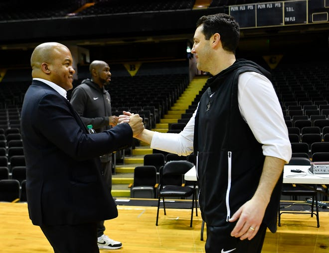 Vanderbilt's new athletics director, Malcolm Turner, left, shakes hands with basketball coach Bryce Drew as he visits with the team Friday.