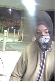 A surveillance picture of a suspect police say held up a person at an ATM in Brentwood.