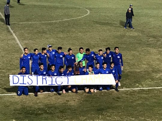 The Clewiston High School boys soccer team celebrates its Class 2A-District 12 championship after beating Bishop Verot, 3-1, on Friday.