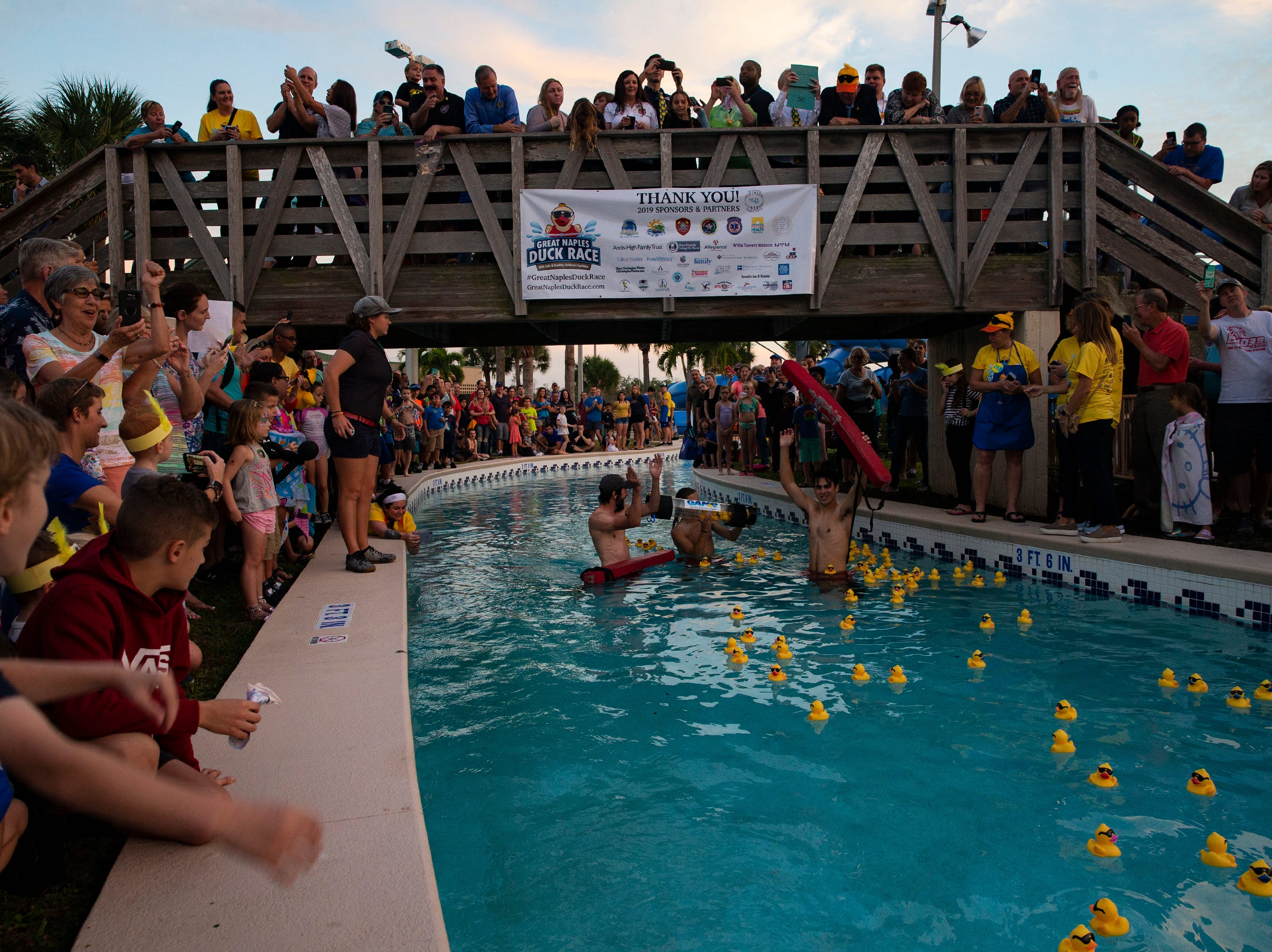 Community member cheer as the winning duck is collected during the Great Naples Duck Race on Saturday in North Collier Regional Park.