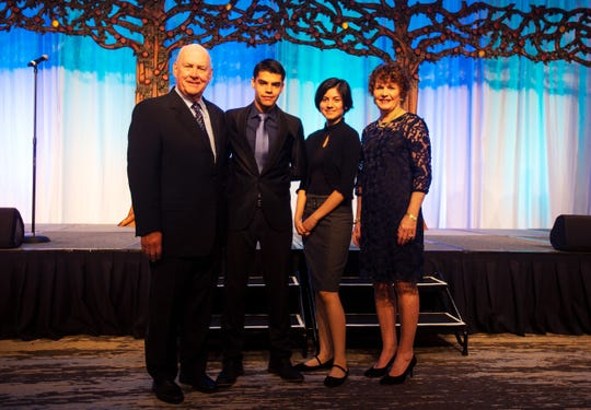 From left, Chuck Carlsen, Fernando Orellana, Isabel Leija-Cabrera and Corky Carlsen stand for a photo at the Night of Champions Gala at the Naples Grande Beach Resort on Friday, Feb. 1 2019.
