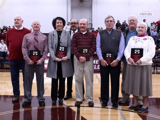 Mark Doughty, from left, Nancy Pound Barker, Barry West, Jerry Larason and Larry Gatrell (not pictured), were inducted into the Newark High School Athletic Hall of Fame.