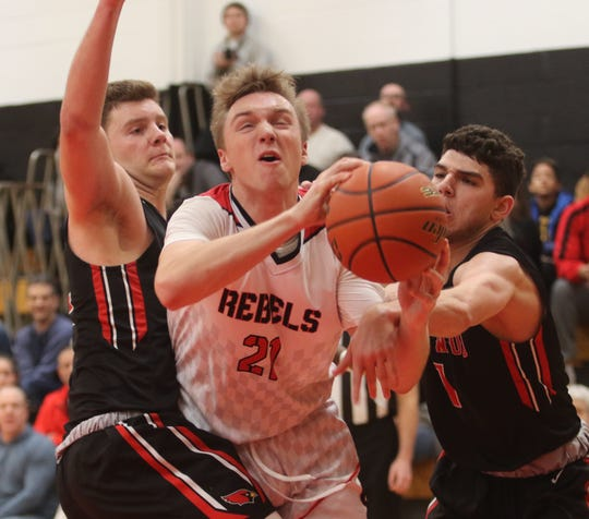 Steven Riedel and Scott Rosenfeld of Westwood try to keep Connor Cyran of Saddle River Day from going to the basket.