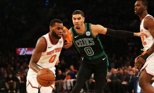 Feb 1, 2019; New York, NY, USA; New York Knicks guard Kadeem Allen (0) dribbles the ball past Boston Celtics forward Jayson Tatum (0) during the first half at Madison Square Garden.