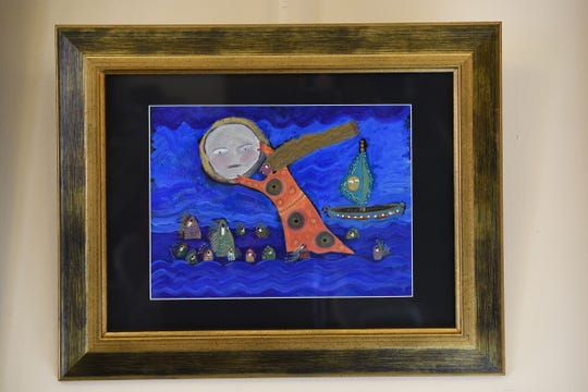 An art reception for the exhibit, Women Dreaming of Doors: Paintings and Prints by Linda Hillringhouse at Passaic County Community College Art Galleries in Paterson, NJ on Saturday February 02, 2019. Stealing the Moon, on of Hillringhouse's pieces in the exhibit.