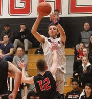 Nick Eiler of Saddle River Day goes up for the shot over Dylan Cipolla of Westwood in the first half.