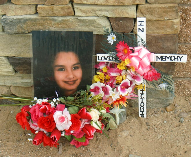 This Feb. 23, 2009 file photo shows a memorial for Victoria Chavez near the area where bodies have been discovered on the west side of Albuquerque, N.M.