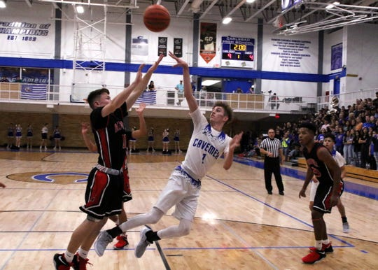 Carlsbad's Josh Sillas gets off a contested jump shot in the first half of the Feb. 1 game against Roswell. Sillas finished with 22 points.