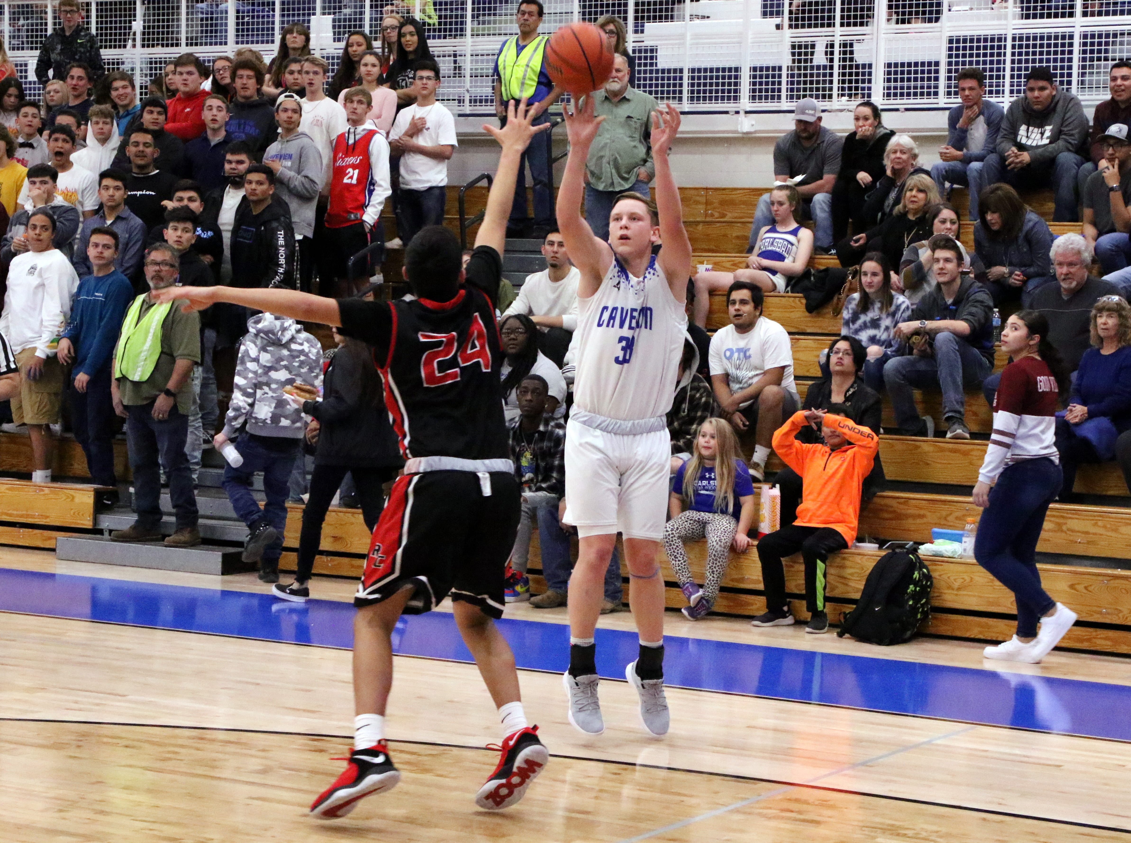 Ayden Parent takes a 3-point shot in the first half against Roswell on Friday. He finished with four points.