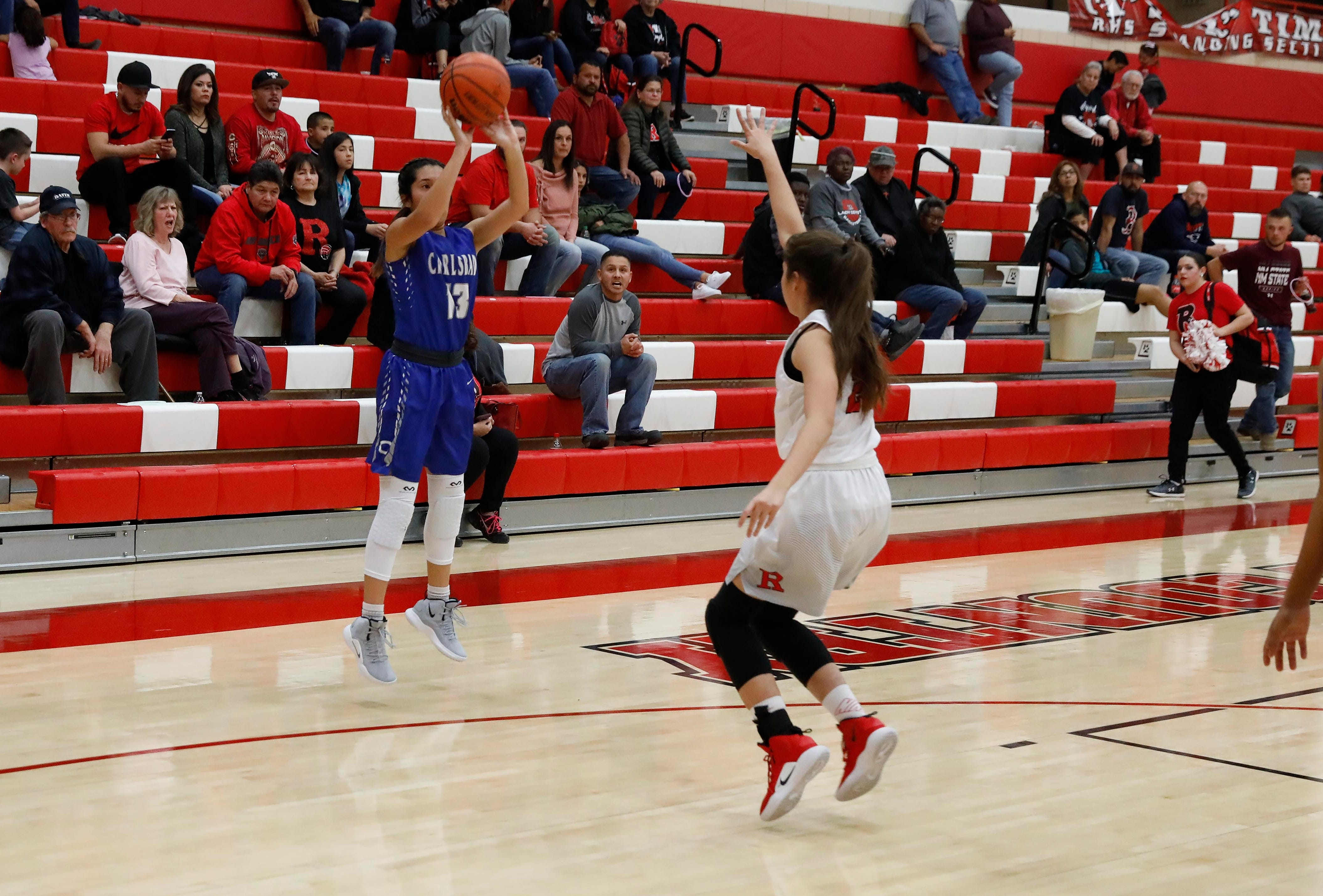 Tori Flores hits an open three for Carlsbad.