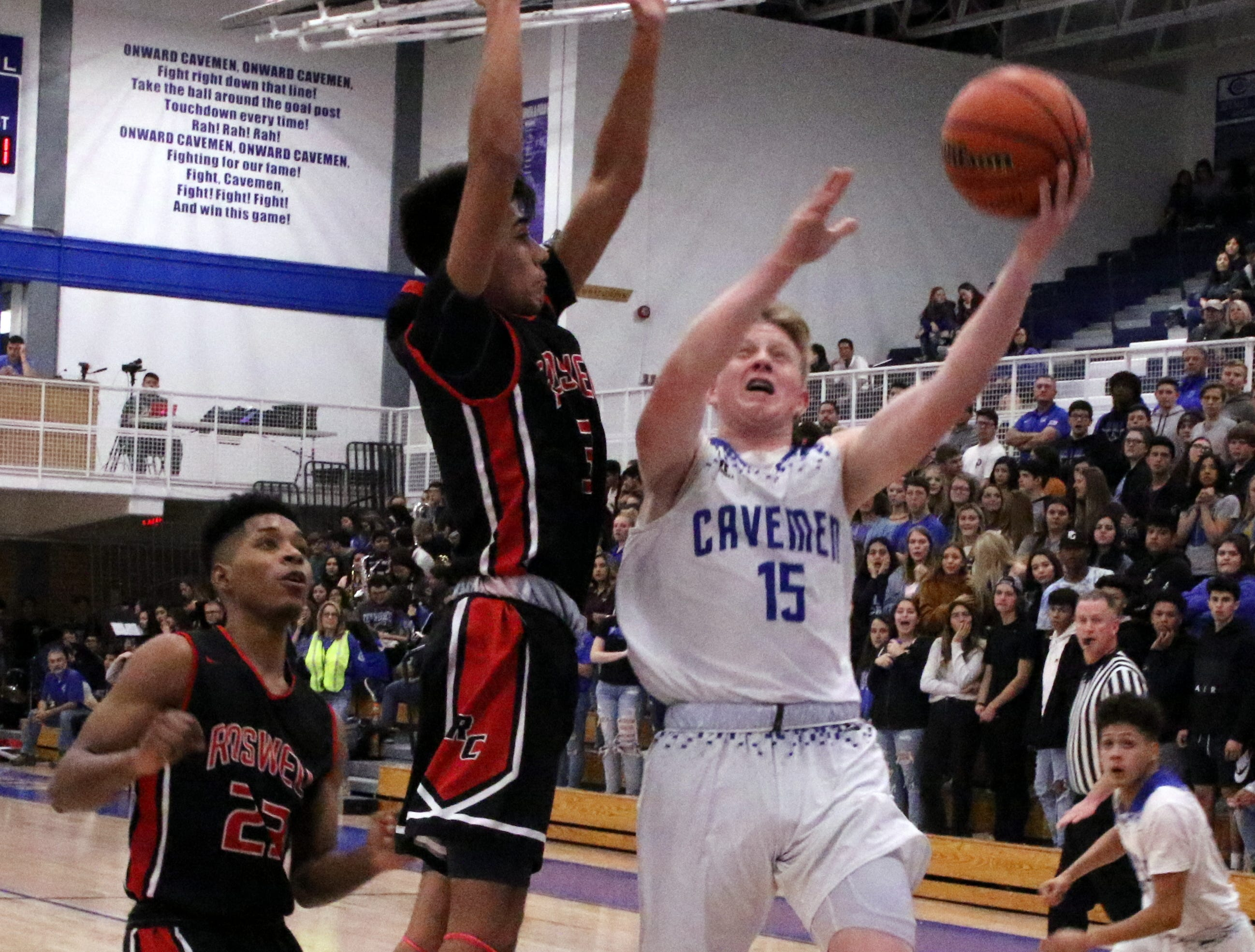 Carlsbad's Andrew Miller takes a contested layup in the first half of Friday's game against Roswell. He finished with four points.