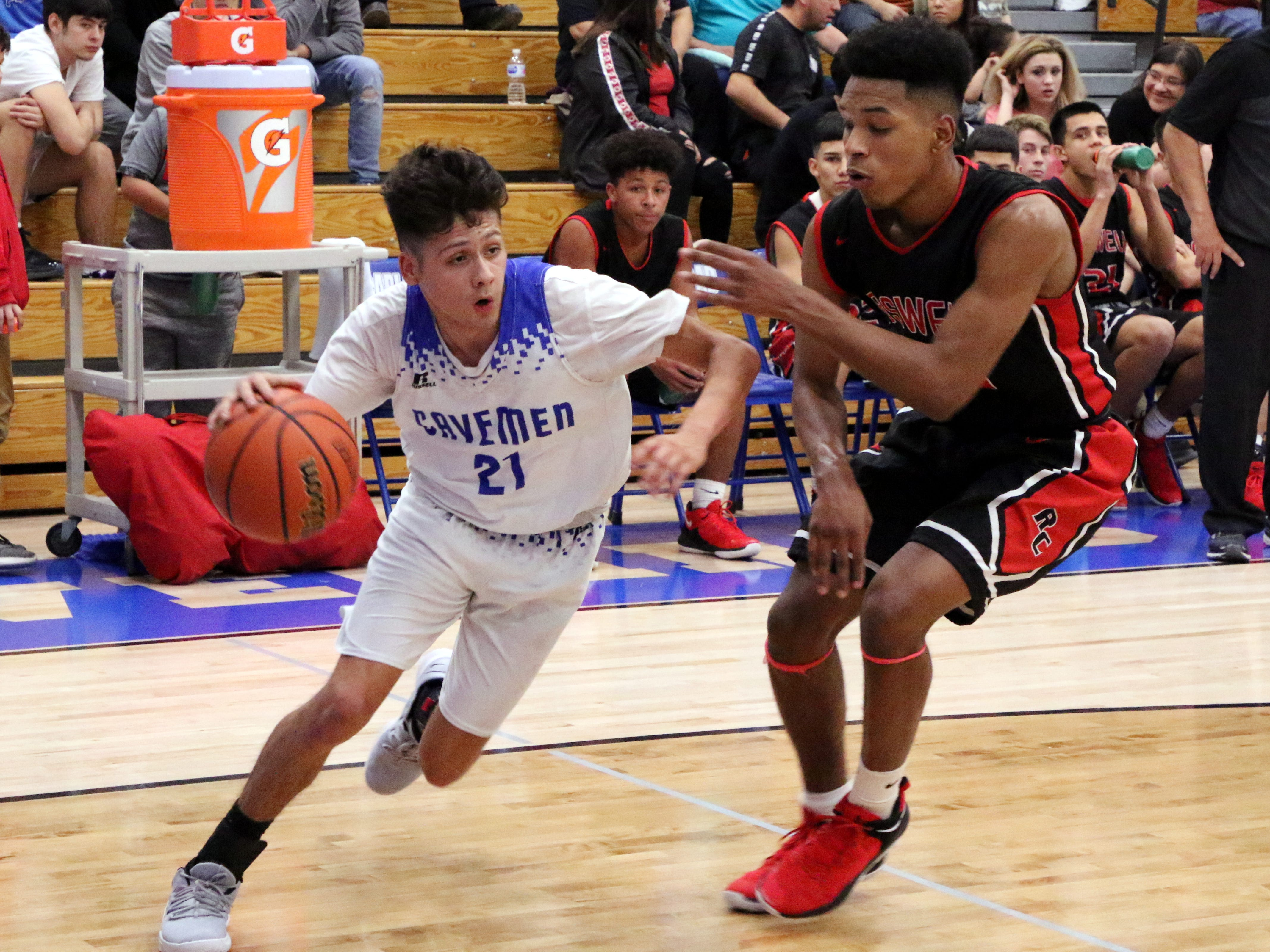 Carlsbad's Pat Espinoza drives the lane in the first half of Friday's game against Roswell. He finished with 14 points.