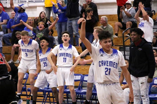 The Carlsbad bench erupts after Pat Espinoza (21) drains a trey to tie the game late in the fourth quarter on Friday against Roswell. Espinoza finished with 14 points.
