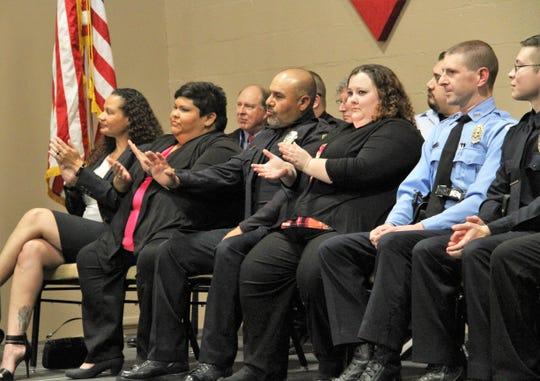 Crisis Intervention Team program graduates clap during their ceremony Thursday, Jan. 31, 2019.